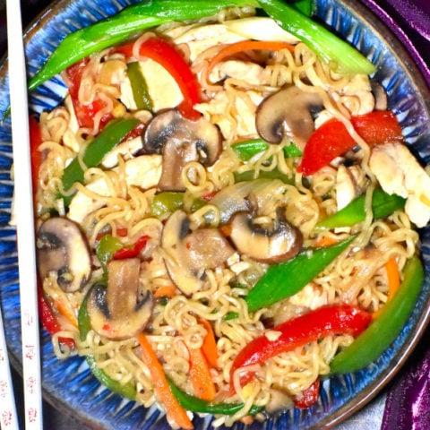 healthy chicken ramen stir fry in a blue bowl