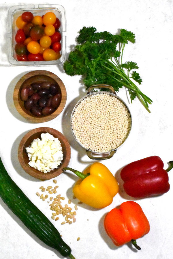 ingredients for couscous salad on a white background