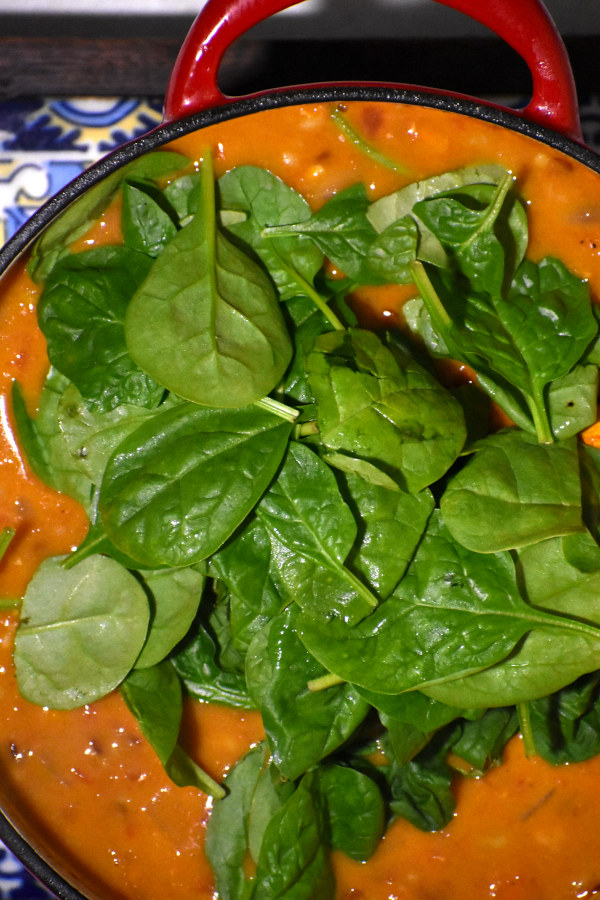 raw spinach added to the soup