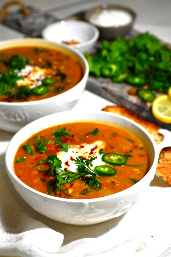 side view of two bowls of moroccan lentil soup