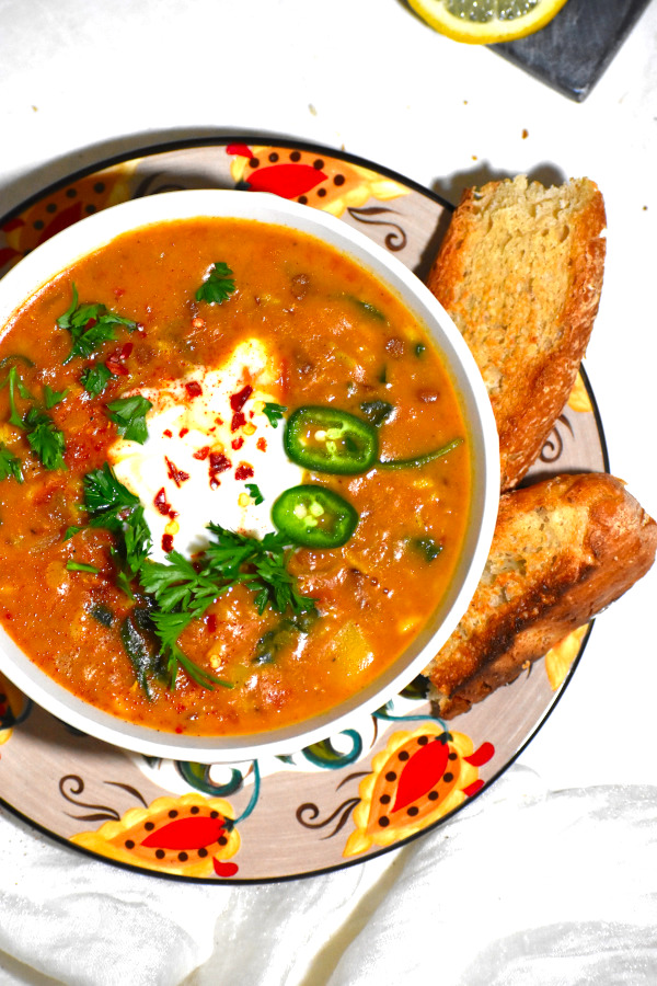 moroccan lentil soup in a bowl atop the gypsy plate
