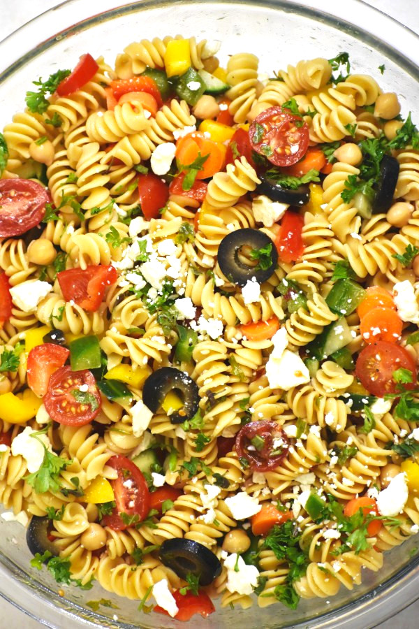 rainbow pasta salad in a large glass bowl