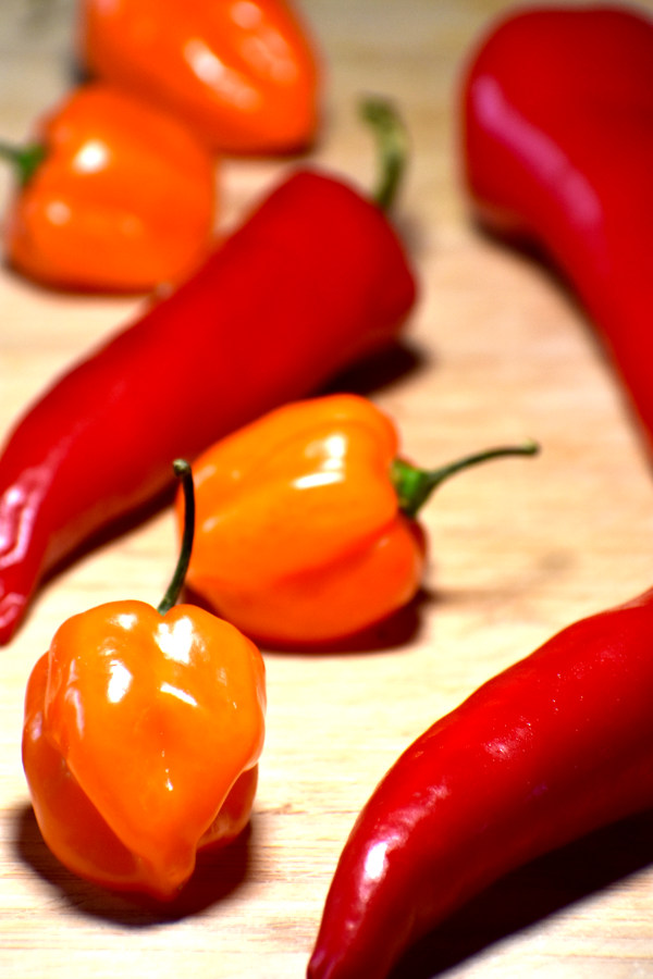 some hot peppers on a cutting board