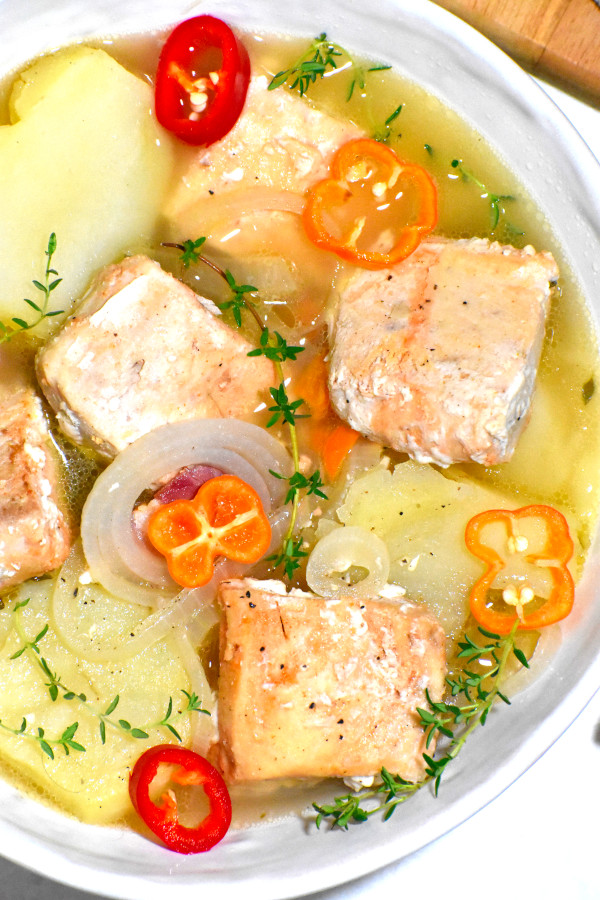 close up image of bahamian boiled fish in a white bowl