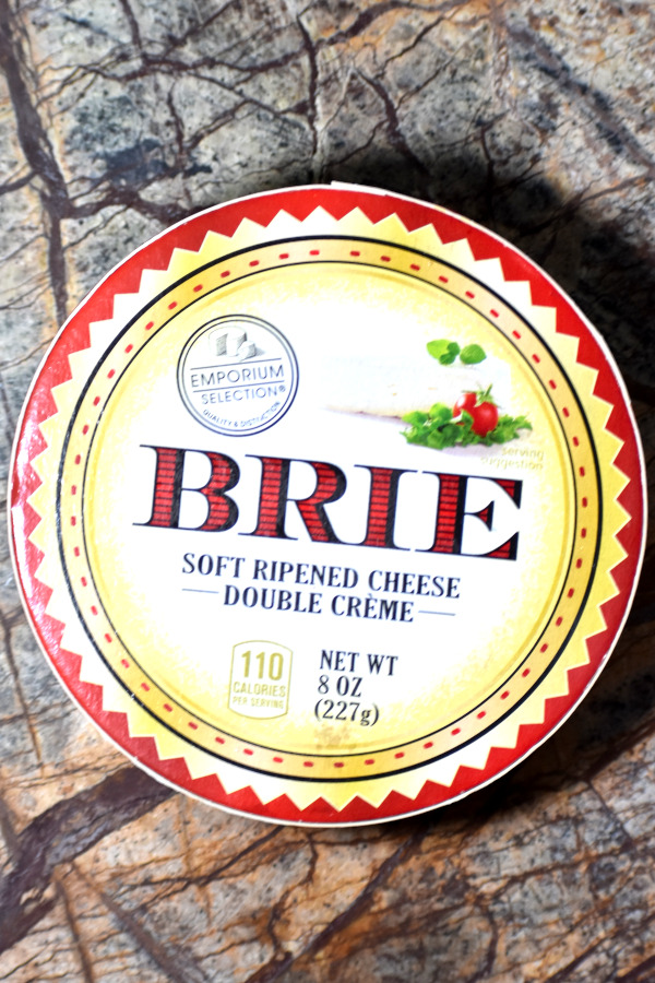 an 8 ounce package of brie