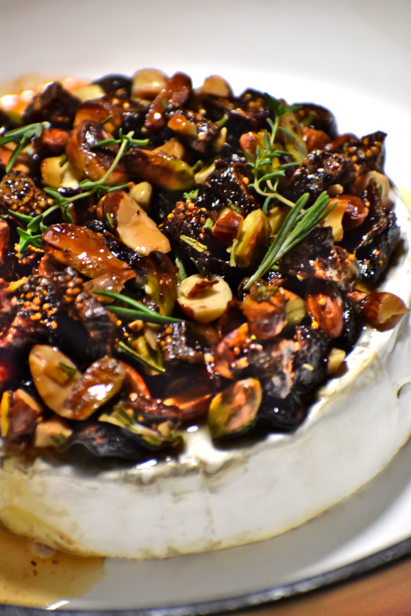 a nice round of brie topped with nuts and stuff