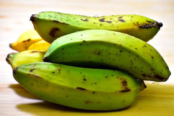 a pile of unripe plantains