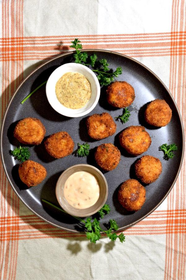 overhead shot of several sauerkraut balls on a grey plate