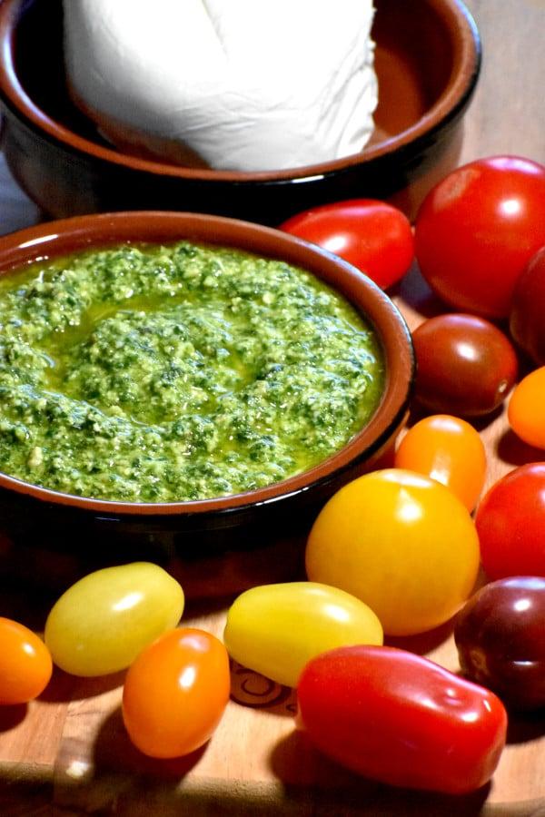cherry tomatoes, fresh mozzarella and a dish of pesto sauce