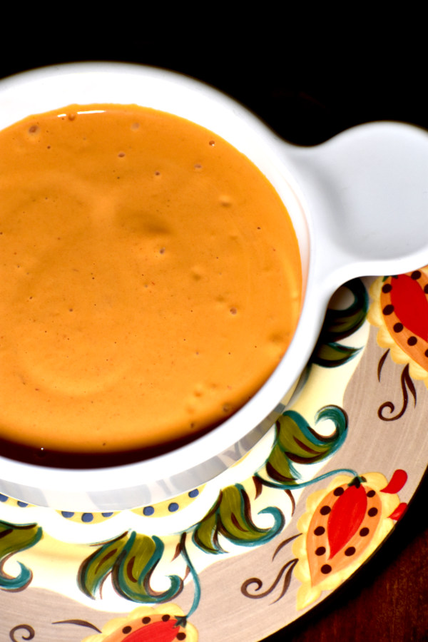 chipotle mayo in a white dish atop the gypsy plate