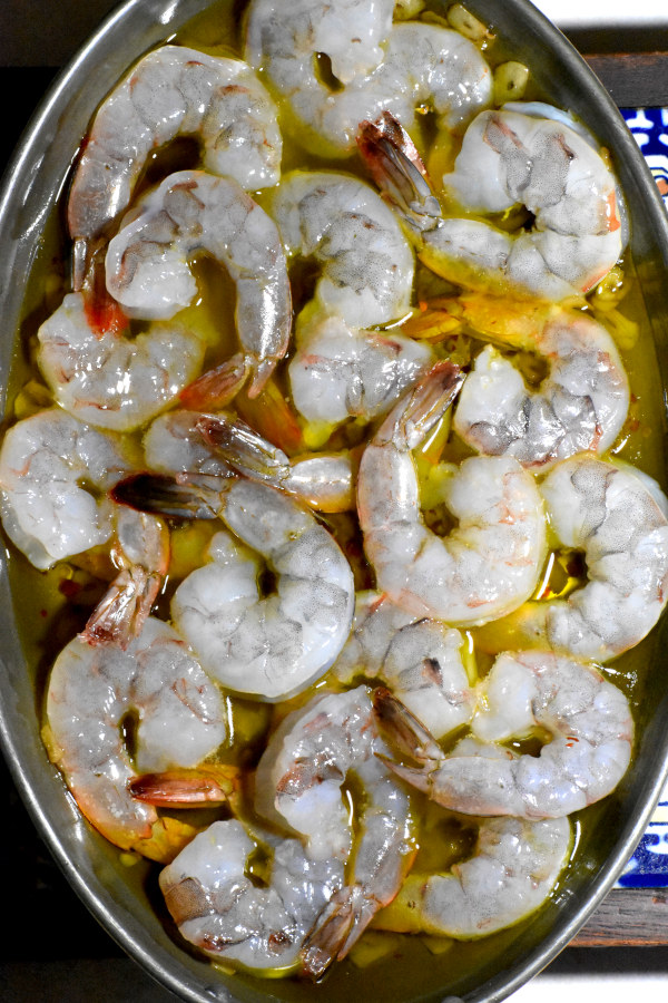 Shrimp added to the oil mixture.