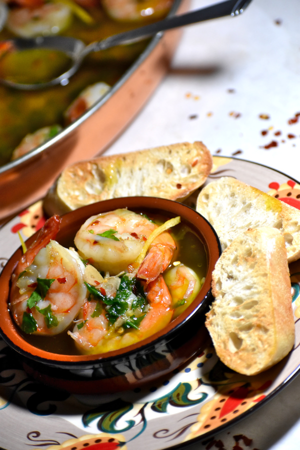 A little dish of gambas al ajillo on the gypsy plate, alongside some pieces of crusty bread.