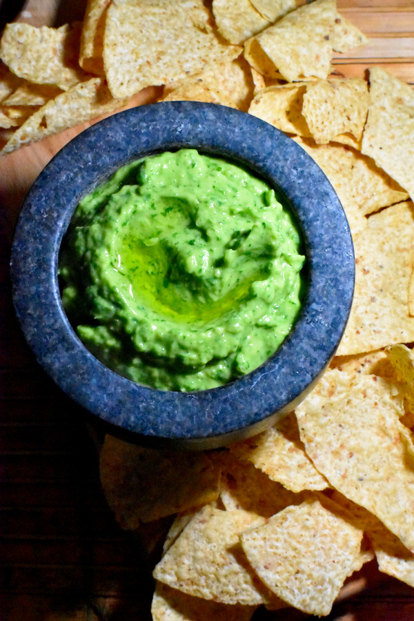 our mortar full of this great avocado sauce alongside a big pile of tortilla chips