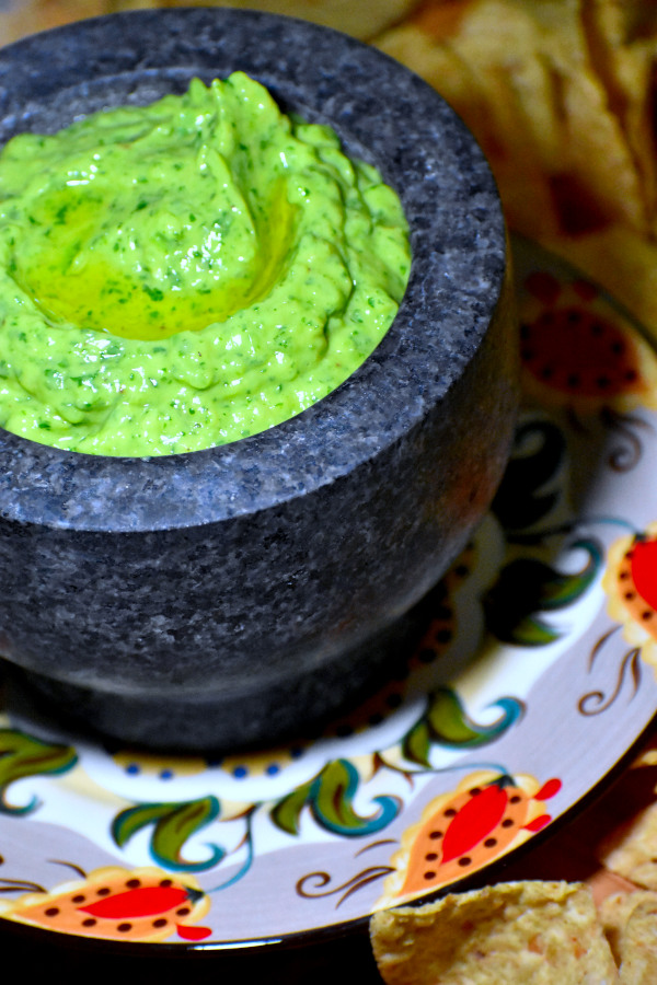 guasacaca in a stone mortar atop the gypsy plate