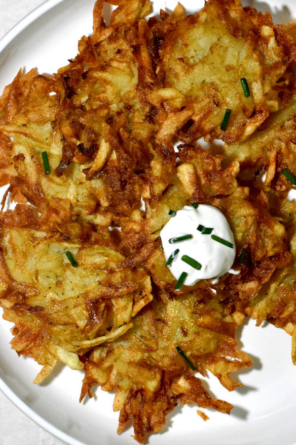 a dollop of sour cream atop some of our latkes
