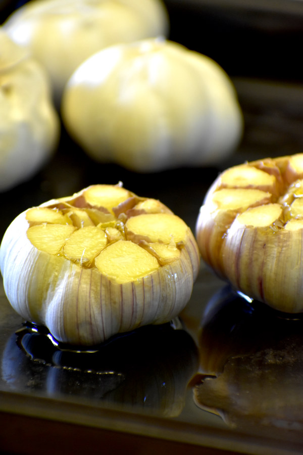 two heads of garlic with the tops cut off