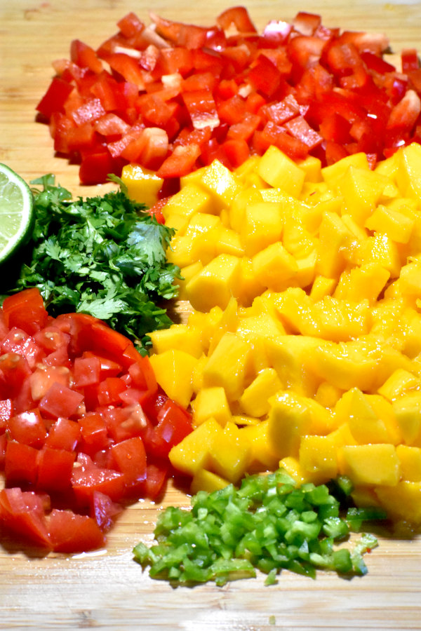 ingredients for mango salsa chopped on a cutting board