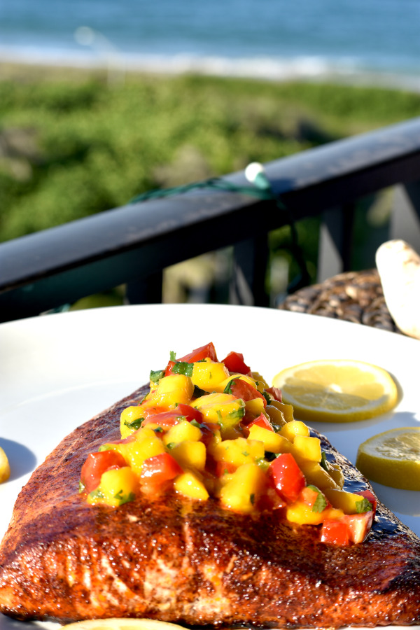 our baked salmon on a plate on the balcony overlooking the ocean
