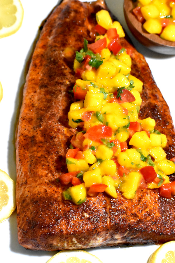 the cooked slab of salmon topped with mango salsa