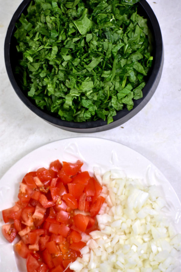 Diced onio0ns, tomatoes and spinach.