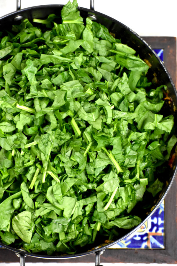 Spinach added to the pot.