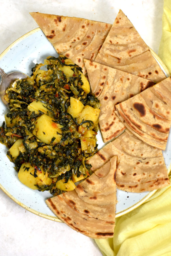 These tasty sauteed spianach and potatoes alongside some freshly cooked rotis.