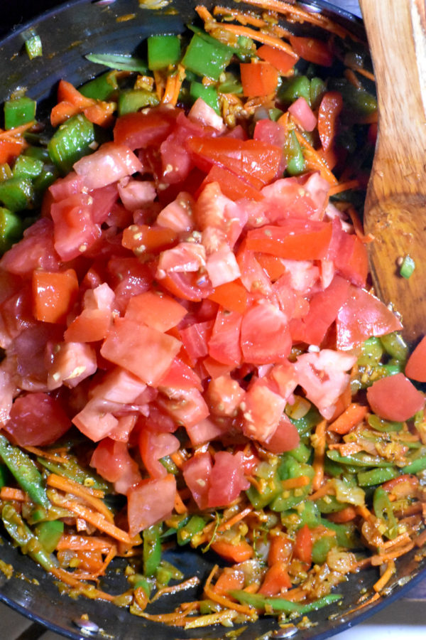 Everything has been mixed, now chopped tomatoes are added.
