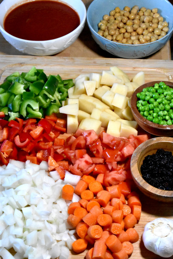 All of the ingredients, minus the pork, for this recipe arranged on a cutting board.