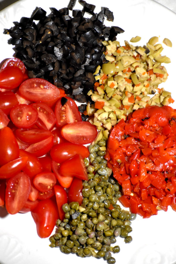 Chopped tomatoes, roasted red peppers, olives and capers.