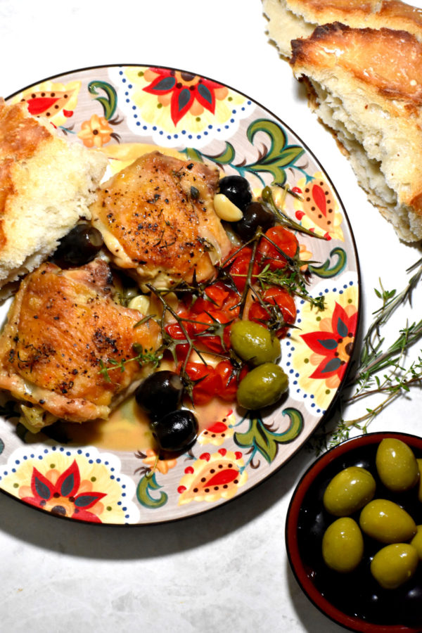 A serving of Chicken Provençal and a piece of crusty bread on the Gypsy Plate.