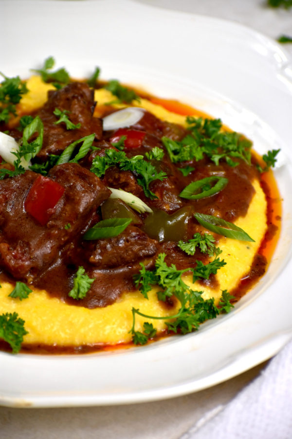 Side view of grillades and grits.