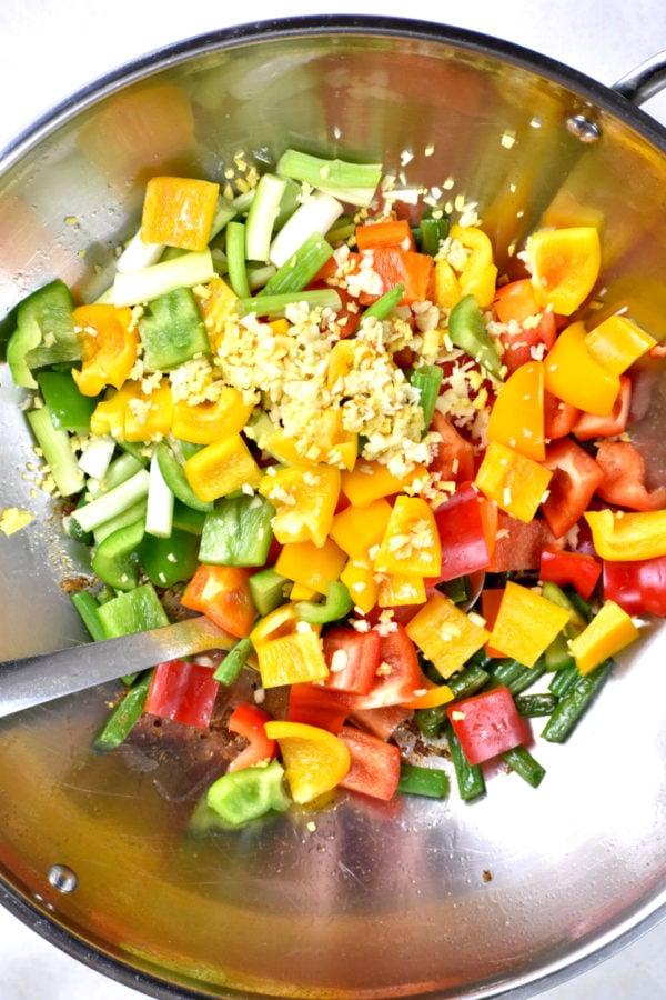 Veggies and aromatics in the wok.