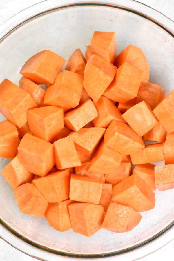 Diced, uncooked sweet potato chunks.
