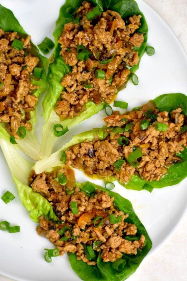 Platter of four chicken lettuce wraps.