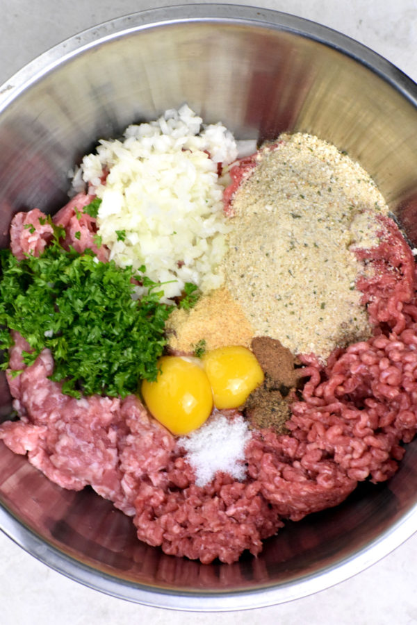 All meatball ingredients in a pan, prior to mixing.