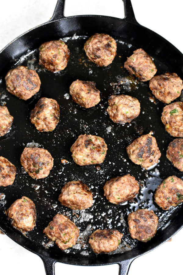 Cooked meatballs in the skillet.