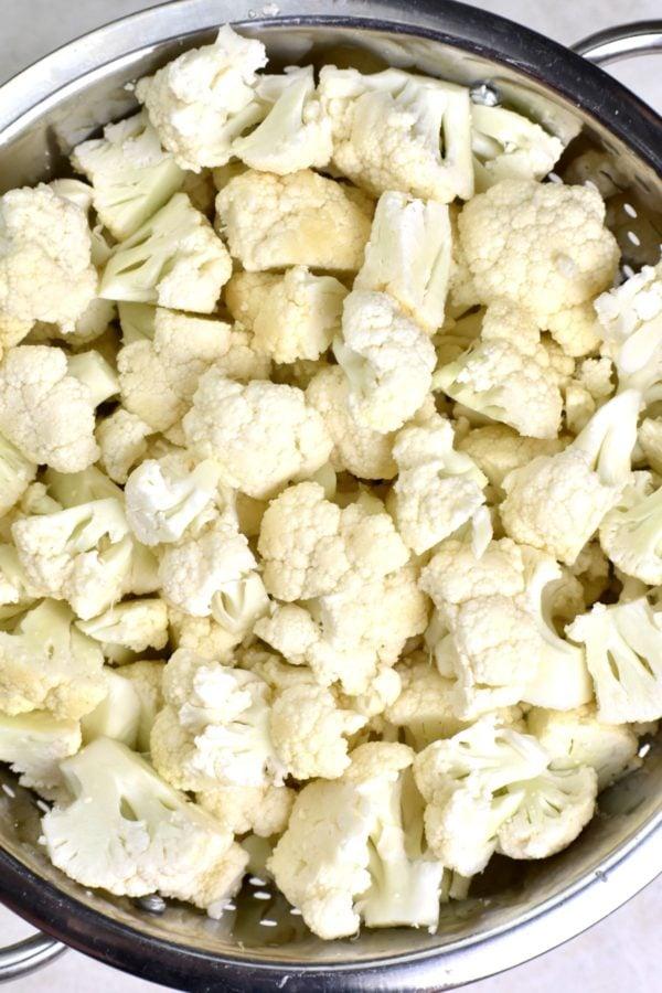 Chopped cauliflower in a colander.