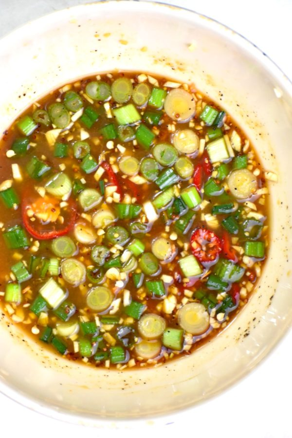 All sauce ingredients mixed in a small white bowl.