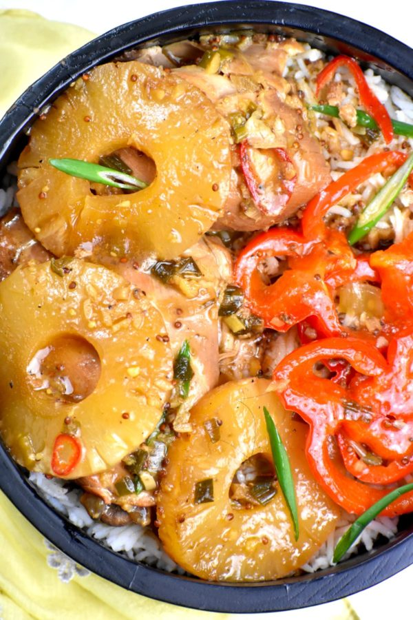 Close up of this Hawaiian chicken dish in a black bowl.
