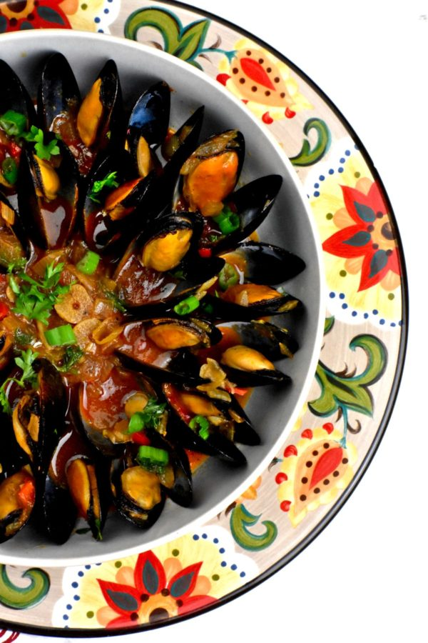 Bowl of mussels atop the Gypsy Plate.