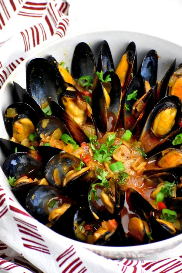 These tasty Portuguese mollusks garnished with parsley and scallions.
