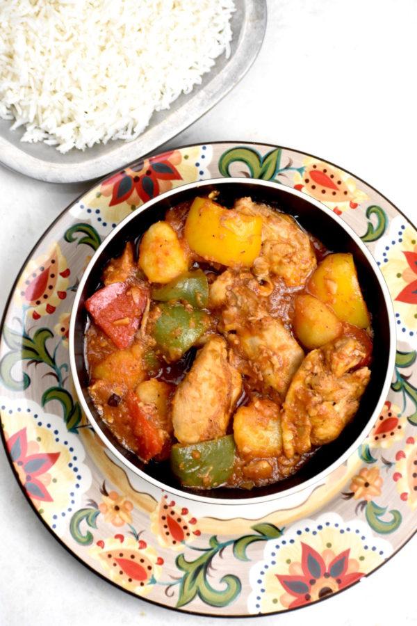 Bowl of chicken asado atop the Gypsy Plate.