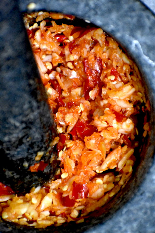 Garlic and chili paste in a mortar.