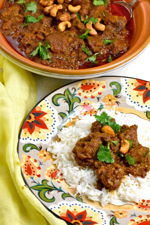 Serving of pork vindaloo atop the Gypsy Plate.
