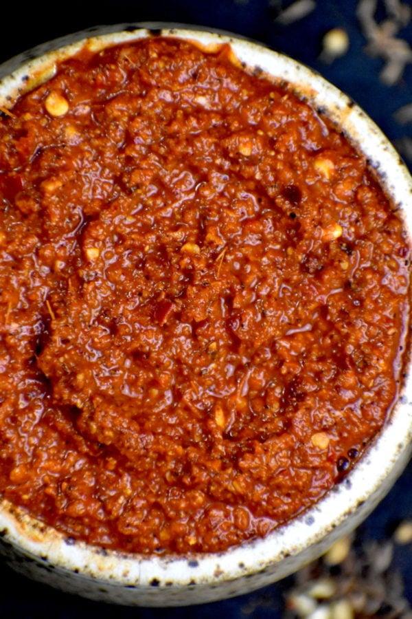 Rustic bowl full of vindaloo paste.