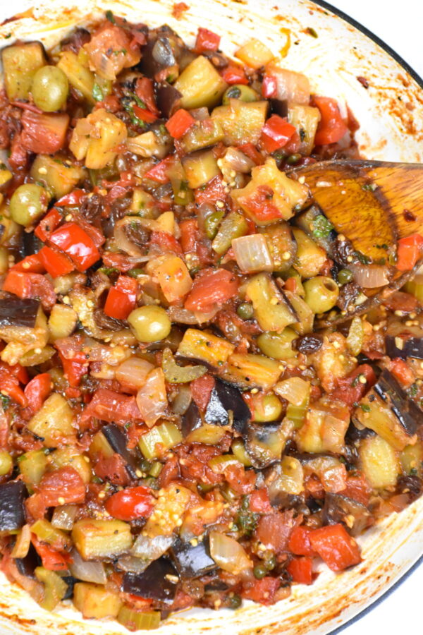 Caponata cooking in a skillet.