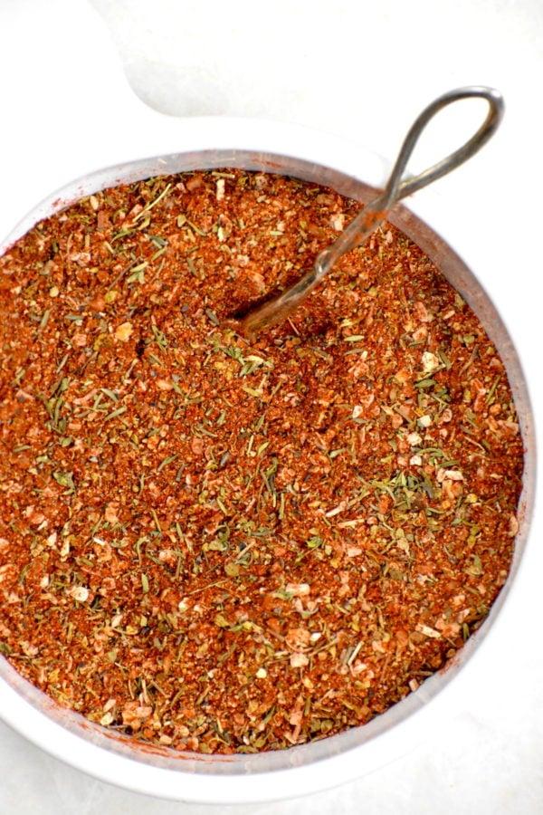Bowl full of homemade Creole seasoning.