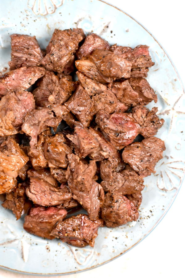 Chunks of seared beef on a plate.