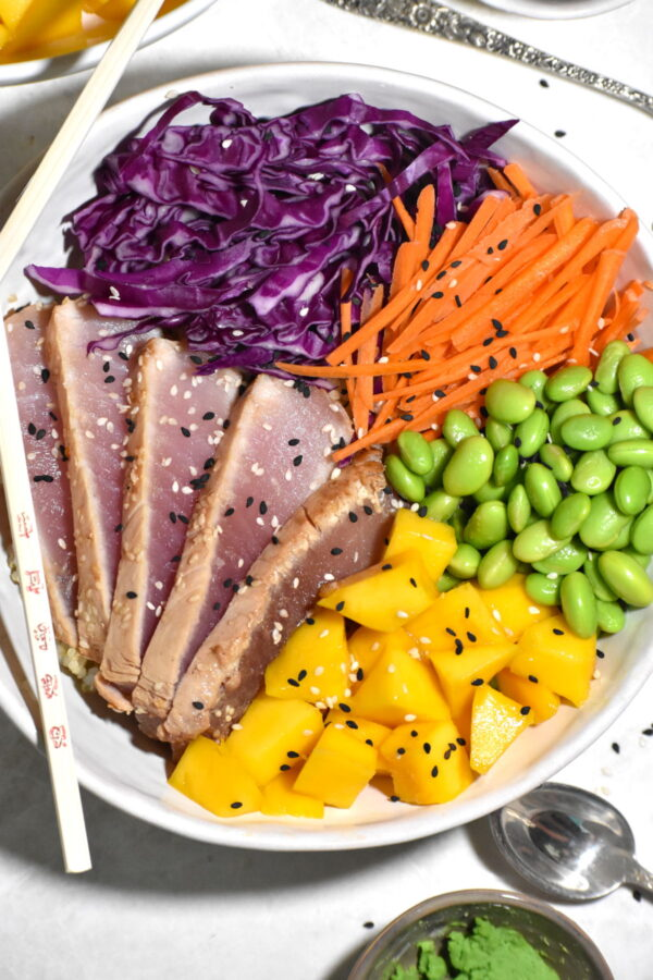 Bowl of albacore tuna, carrots, mango and edamame.