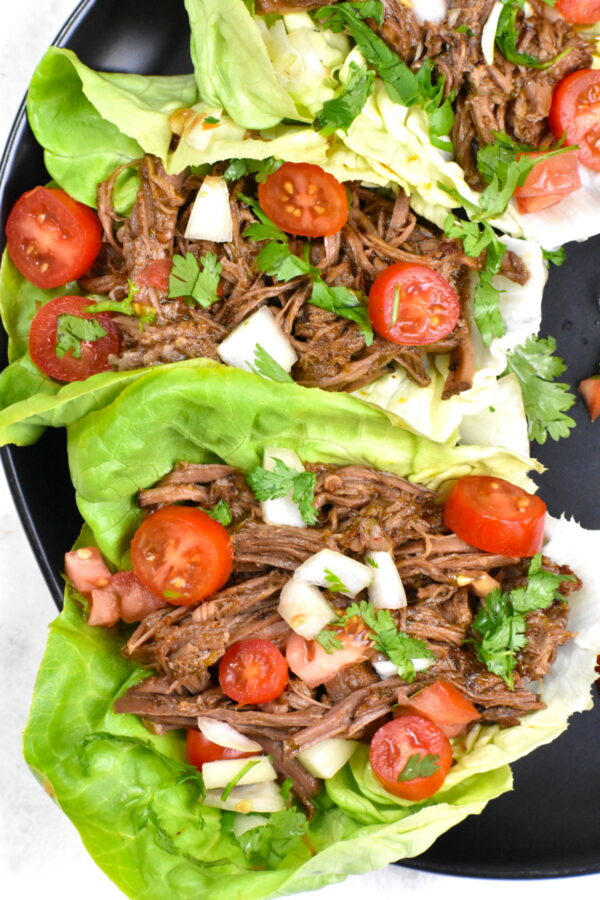 Close up of two barbacoa beef lettuce wraps.